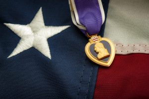 purple heart metal against American flag for a SSDI attorney Chicago