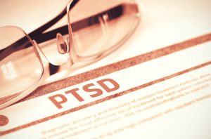 PTSD on a paper with glasses for a top VA benefits attorney Chicago