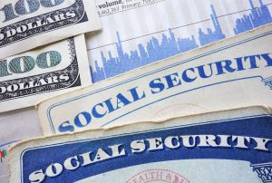 Social Security cards, cash and stock market chart for an oak lawn top disability attorney