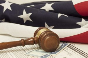 Gavel on Social Security ID ad immigration documents representing the work veterans benefits attorney chicago is doing