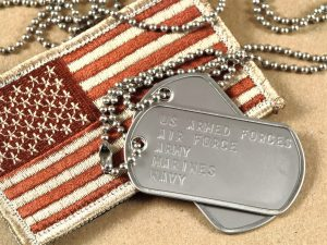Military dog tags and american flag patch for a veterans benefits lawyer chicago