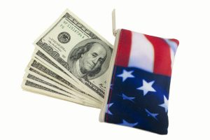 american flag wallet with hundred dollar bills coming out of it belonging to a person who called a VA Benefits lawyer Chicago