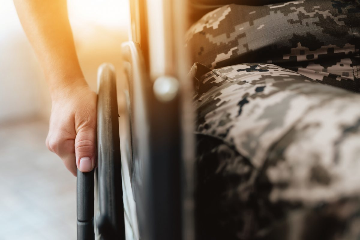 woman veteran in wheelchair seeking assistance with her benefit claim from a Chicago Heights VA Benefit Lawyer