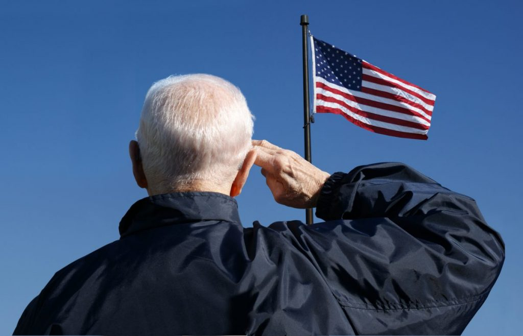 an American veteran saluting the flag, for when needing a good veterans benefits attorney in Chicago Heights.