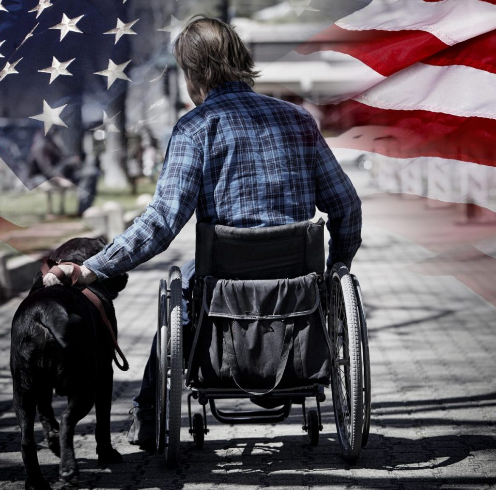man in wheelchair disabled veteran concept for when looking for a Lowell Veterans benefit lawyer.