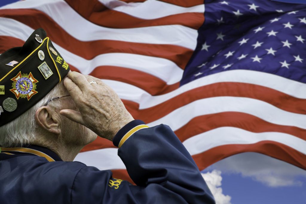 veteran saluting the flag, for dedicating their service to the country seek a skilled veterans benefits attorney in Crown Point.