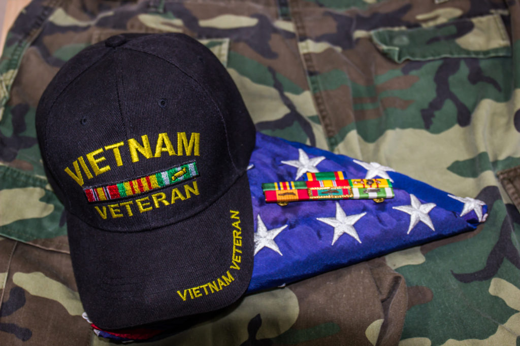 veteran hat with flag and uniform, for the best Lake County VA benefits attorney.