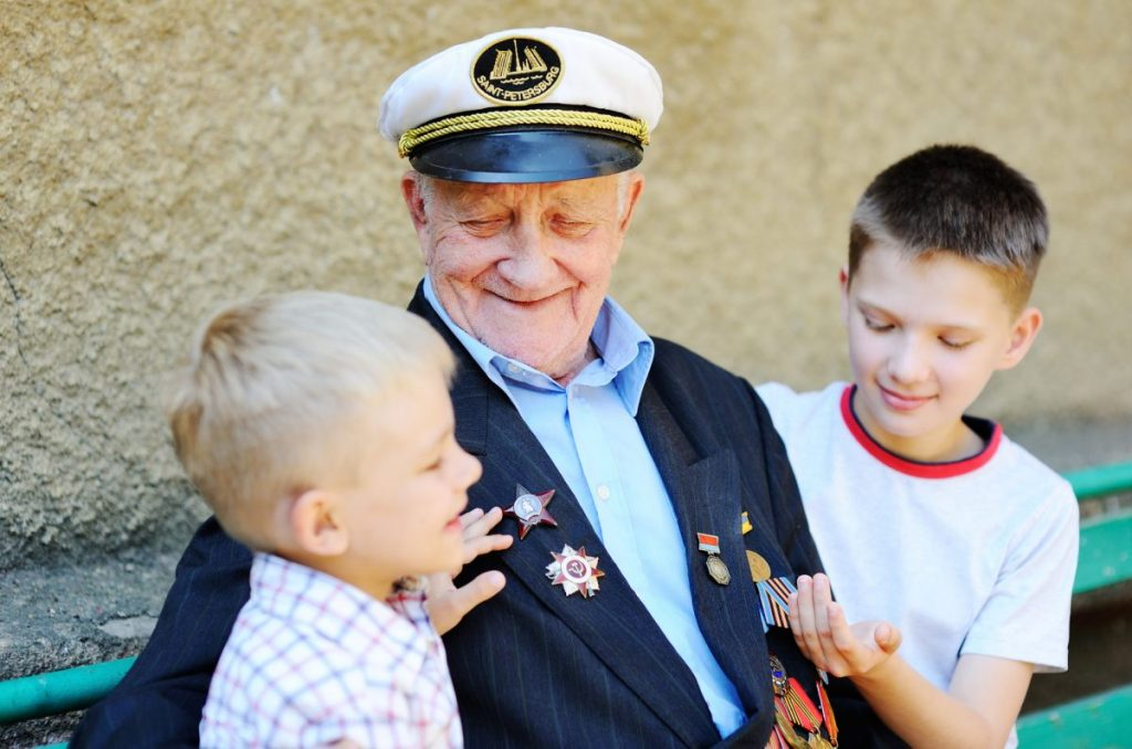 A veteran with his grandchildren representing how if your claim has been denied, a VA benefits attorney may be able to help you