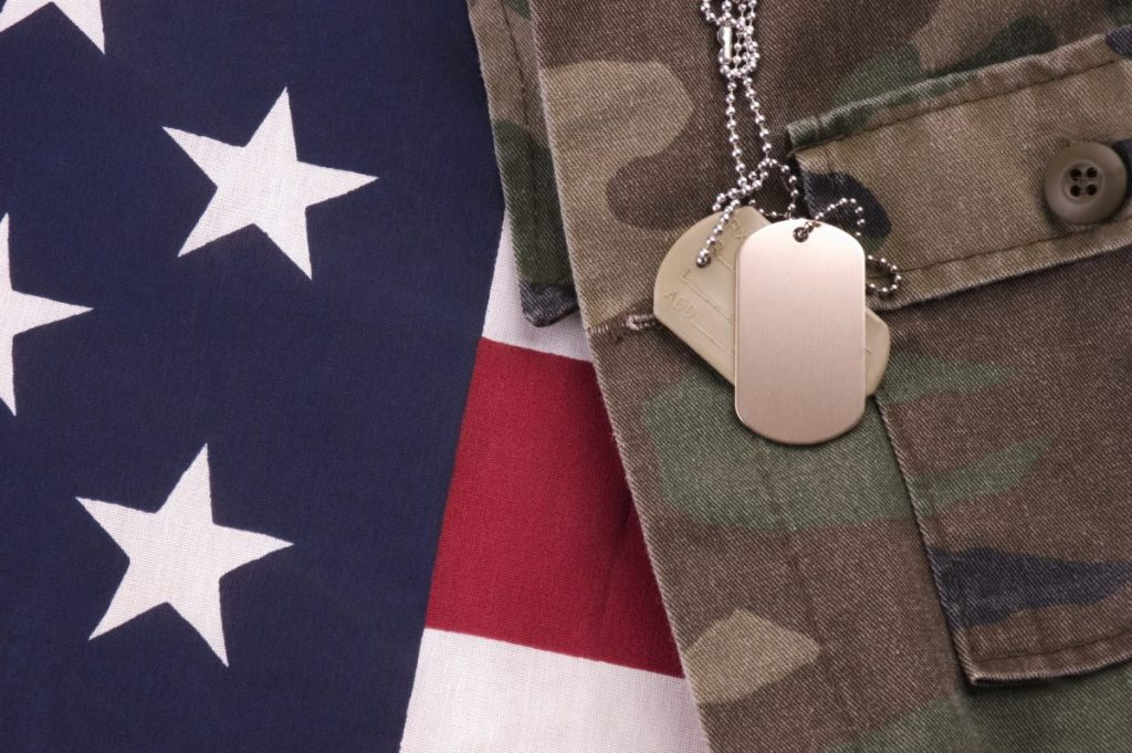 Dog tags on an American flag representing how our VA benefits attorney can help with your case