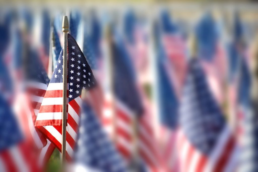 photo of many small American flags representing how our St. John VA attorney can help you with your benefits