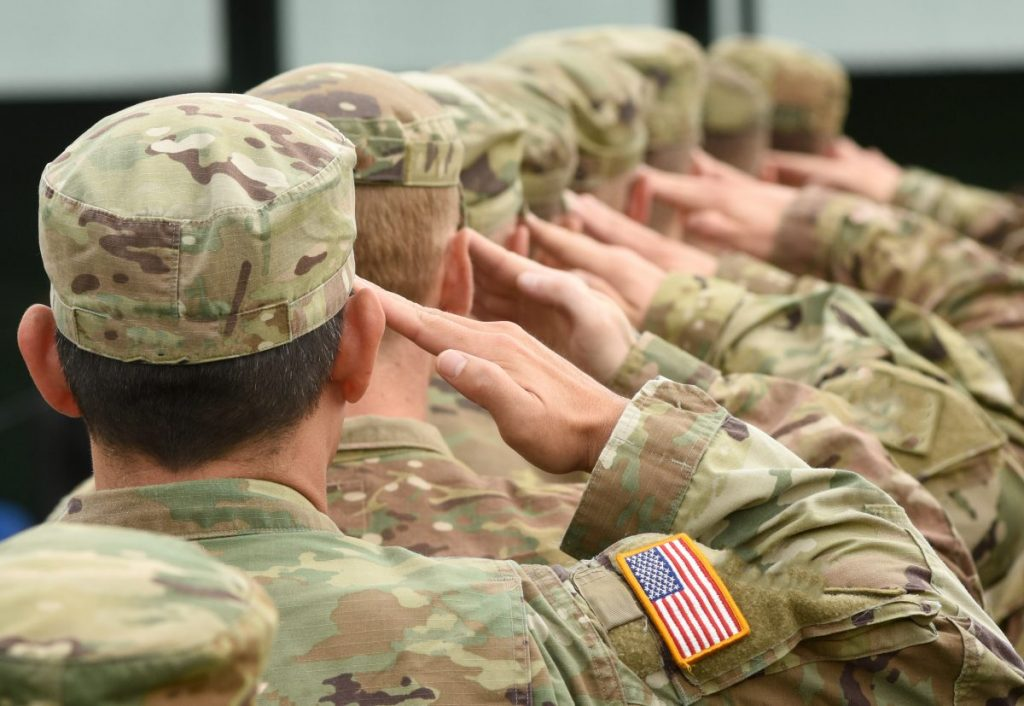 US soldiers saluting representing how our Northwest Indiana VA disability attorney can help you get the benefits you deserve