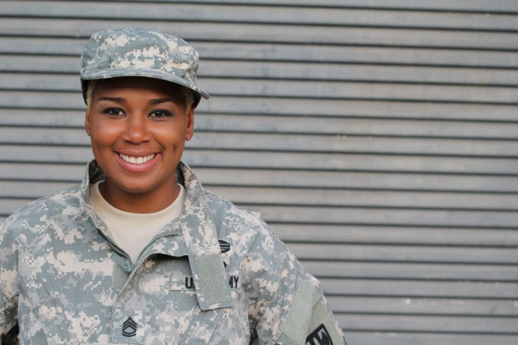 veteran soldier smiling representing how our Cook County VA benefits attorney can help you receive the benefits you deserve