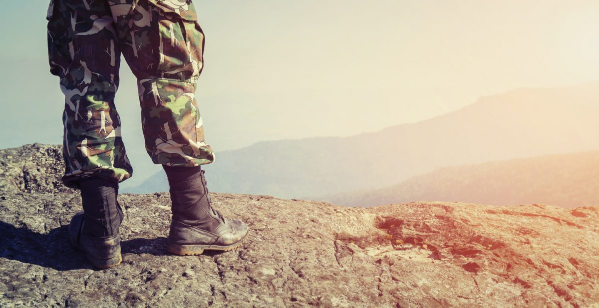 Image of soldier standing on hill, for help with receiving your rightful benefits speak to Illinois Veterans Benefits Lawyer.