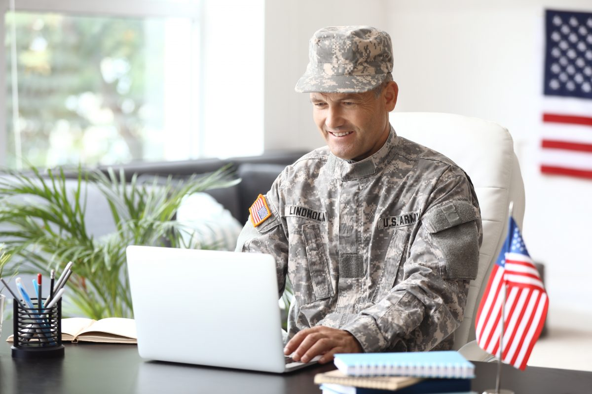 Mature male soldier searching online for Oak Lawn Veterans benefits attorney