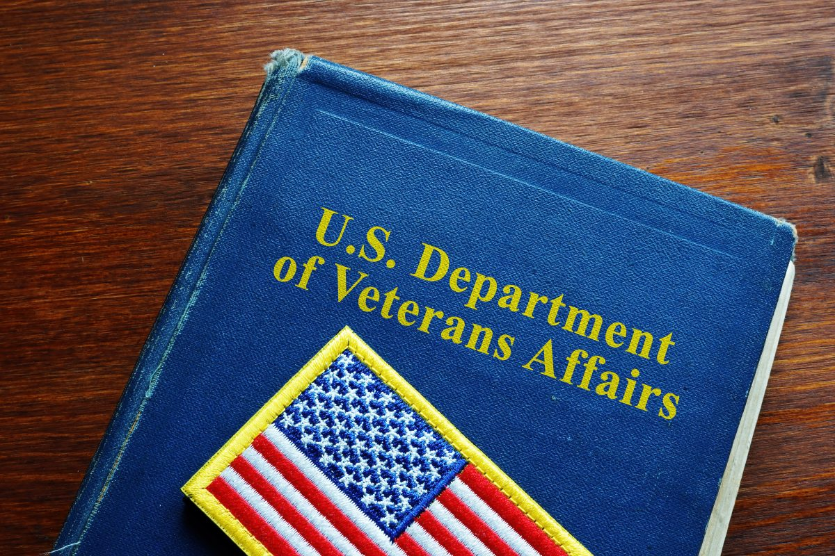 A book marked US Department of Veterans Affairs with a small US flag patch, for guidance with your benefits denial see skilled VA Lawyers Indianapolis.